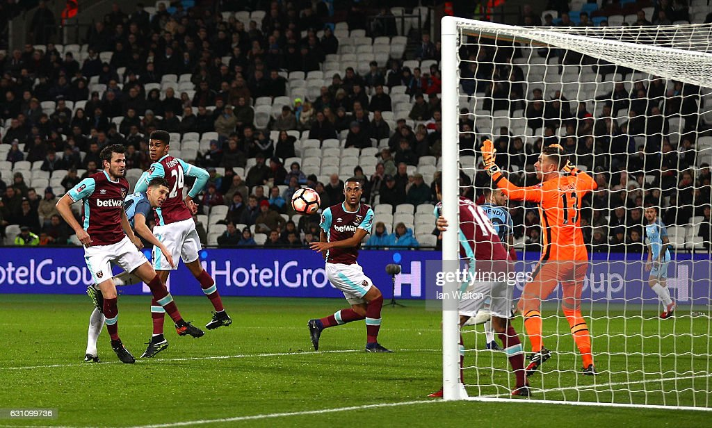 John Stones of Manchester City scores his sides fifth goal during The Emirates FA Cup Third Round match between West Ham United and Manchester City at London Stadium on January 6, 2017 in London, England.
