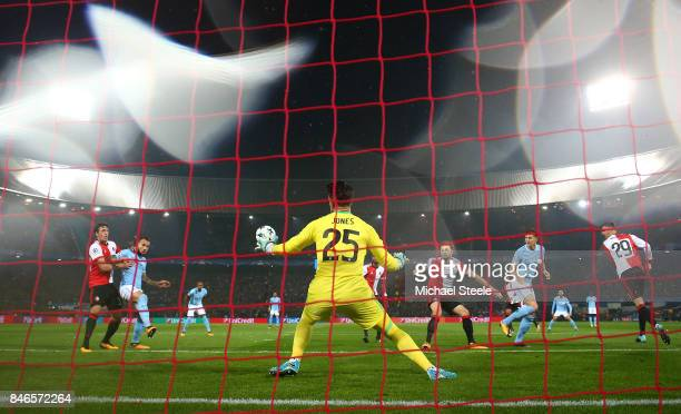 John Stones of Manchester City scores his sides first goal during the UEFA Champions League group F match between Feyenoord and Manchester City at...