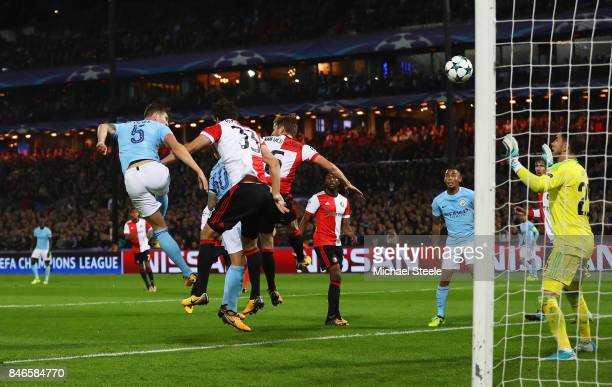 John Stones of Manchester City scores his sides fourth goal during the UEFA Champions League group F match between Feyenoord and Manchester City at...