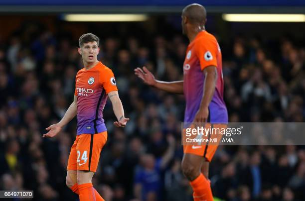 John Stones of Manchester City shrugs his shoulders at Vincent Kompany of Manchester City during the Premier League match between Chelsea and...