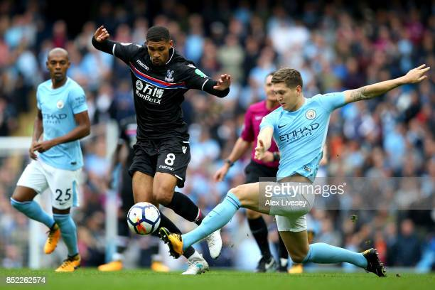 John Stones of Manchester City tackles Ruben LoftusCheek of Crystal Palace during the Premier League match between Manchester City and Crystal Palace...