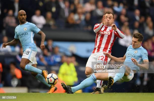 John Stones of Manchester City tackles Xherdan Shaqiri of Stoke City during the Premier League match between Manchester City and Stoke City at Etihad...
