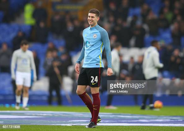John Stones of Manchester City warms up prior to kickoff during the Premier League match between Everton and Manchester City at Goodison Park on...