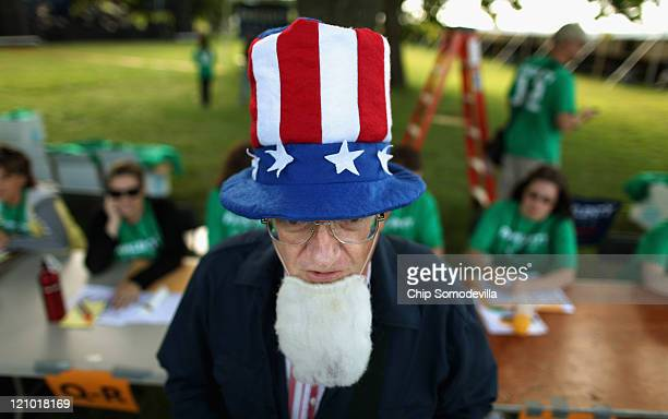 John Strong of West Des Moines Iowa dresses as Uncle Sam outside the Hilton Coliseum where Iowans will vote in the Iowa Straw Poll at Iowa State...