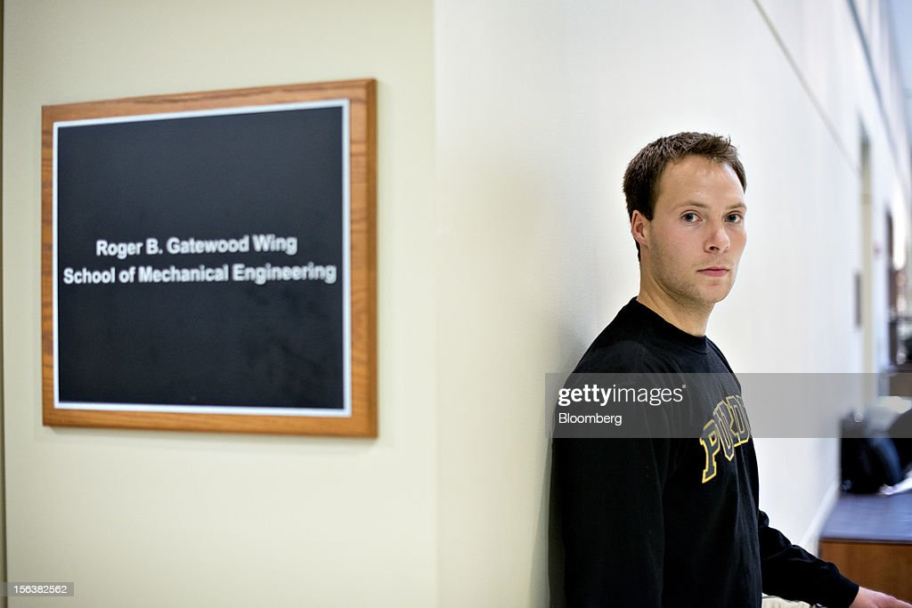 John Stucker, a Purdue University senior mechanical engineering student, stands for a portrait in the Mechanical Engineering Building in West Lafayette, Indiana, U.S., on Monday, Oct. 22, 2012. Stucker must pay back $80,000 he took out in student loans or borrowed from his parents. Administrative costs on college campuses are soaring, crowding out instruction at a time of skyrocketing tuition and $1 trillion in outstanding student loans. At Purdue and other U.S. college campuses, bureaucratic growth is pitting professors against administrators and sparking complaints that tight budgets could be spent more efficiently. Photographer: Daniel Acker/Bloomberg via Getty Images