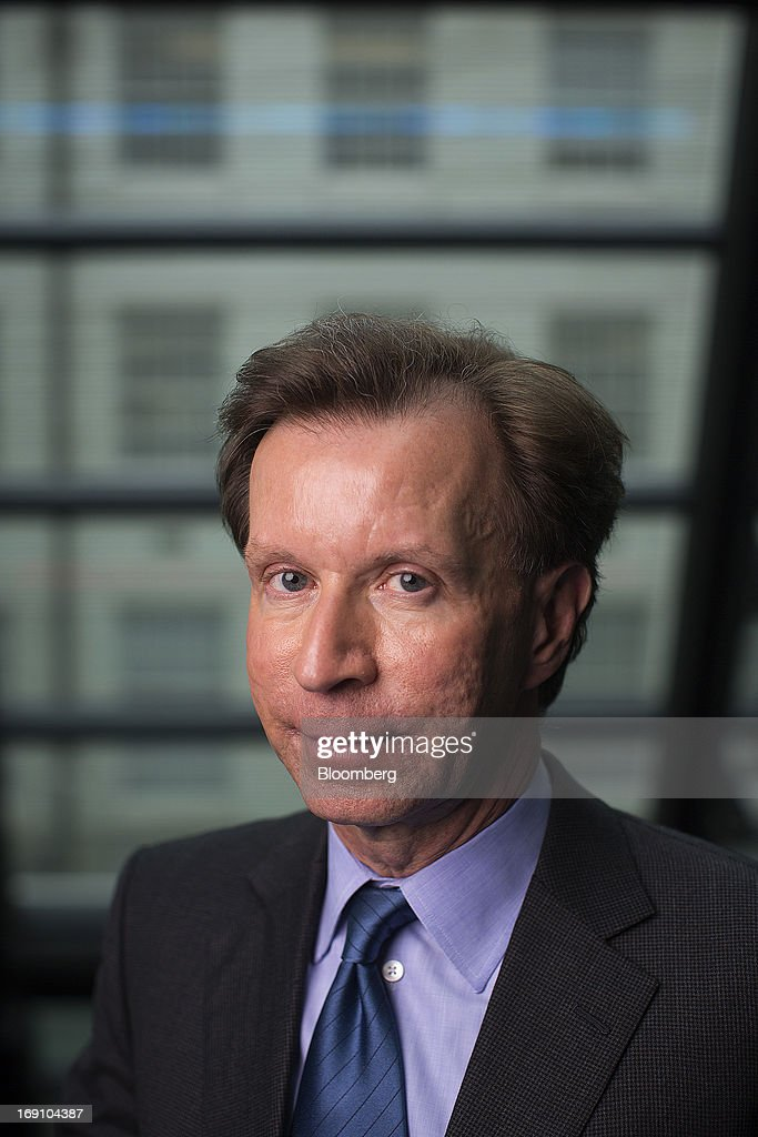 John Studzinski, senior managing director of Blackstone Group LP, poses for a photograph following a Bloomberg Television interview in London, U.K., on Monday, May 20, 2013. Blackstone Group LP is considering an initial public offering of its Brixmor Property Group shopping-center unit by year's end, taking advantage of a stock-market rally as it starts to sell real estate assets. Photographer: Simon Dawson/Bloomberg via Getty Images