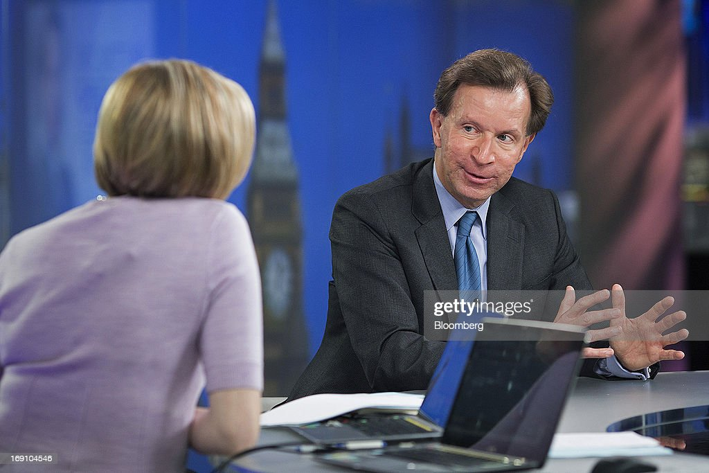 John Studzinski, senior managing director of Blackstone Group LP, right, gestures during a Bloomberg Television interview in London, U.K., on Monday, May 20, 2013. Blackstone Group LP is considering an initial public offering of its Brixmor Property Group shopping-center unit by year's end, taking advantage of a stock-market rally as it starts to sell real estate assets. Photographer: Simon Dawson/Bloomberg via Getty Images