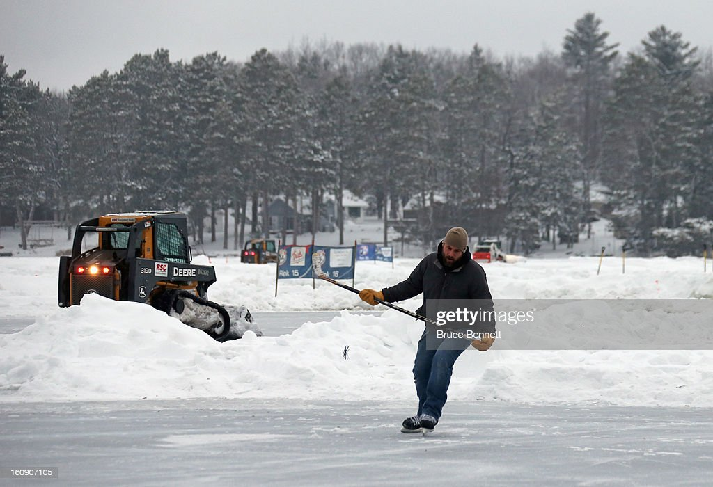 John Suddeth of Washington D.C tests out the ice as workers prepare for the 2013 USA Hockey Pond Hockey National Championships on February 7, 2013 in Eagle River, Wisconsin. The three-day tournament will feature 2,400 participants from 30 states playing a round robin tournament on 28 rinks laid out on Dollar Lake.