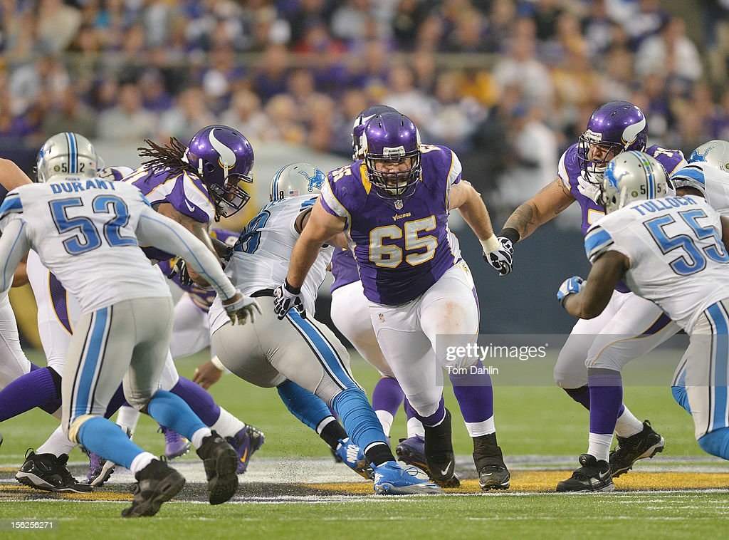 John Sullivan #65 of the Minnesota Vikings blocks during an NFL game against the Detroit Lions at Mall of America Field at the Hubert H. Humphrey Metrodome on November 11, 2012 in Minneapolis, Minnesota.