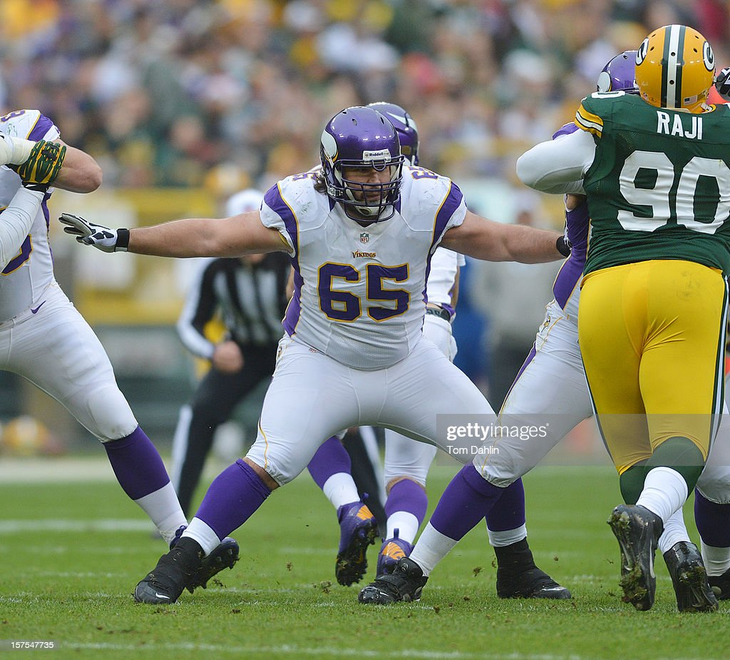 John Sullivan #65 of the Minnesota Vikings blocks during an NFL game against the Green Bay Packers at Lambeau Field on December 2, 2012 in Green Bay, Wisconsin.