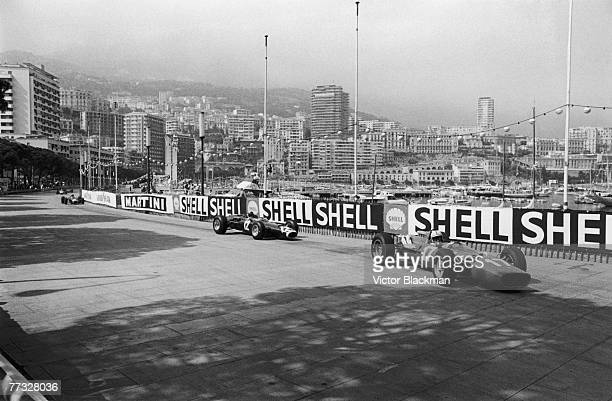 John Surtees in a Ferrari 312 leads Jackie Stewart in a BRM P261 into the chicane during the Monaco Grand Prix in Monte Carlo 22nd May 1966 Surtees...