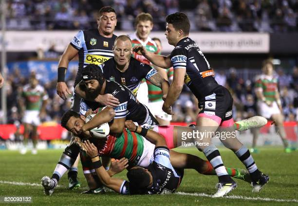 John Sutton of the Rabbitohs crosses to score a try during the round 20 NRL match between the Cronulla Sharks and the South Sydney Rabbitohs at...