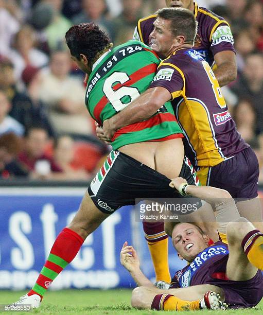 John Sutton of the Rabbitohs has his shorts pulled down by Darren Lockyer of the Broncos as he is tackled by Shane Webcke during the round five NRL...
