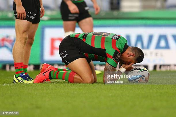 John Sutton of the Rabbitohs holds his eye after a tackle during the round nine NRL match between the South Sydney Rabbitohs and the St George...