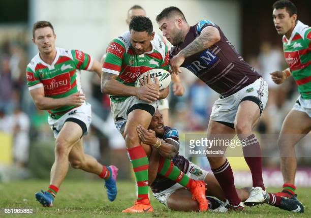 John Sutton of the Rabbitohs is tackled by Curtis Sironen of the Sea Eagles during the round two NRL match between the Manly Sea Eagles and the South...
