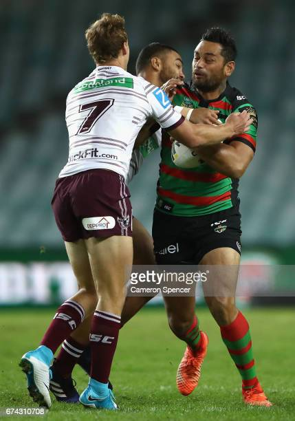 John Sutton of the Rabbitohs is tackled by Daly CherryEvans of the Sea Eagles during the round nine NRL match between the South Sydney Rabbitohs and...