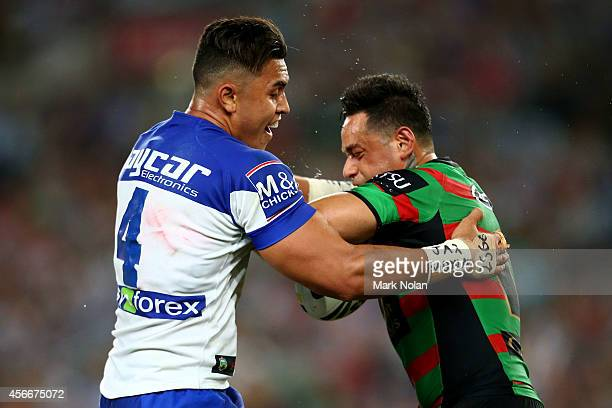 John Sutton of the Rabbitohs is tackled during the 2014 NRL Grand Final match between the South Sydney Rabbitohs and the Canterbury Bulldogs at ANZ...