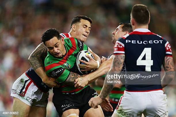 John Sutton of the Rabbitohs is tackled during the First Preliminary Final match between the South Sydney Rabbitohs and the Sydney Roosters at ANZ...