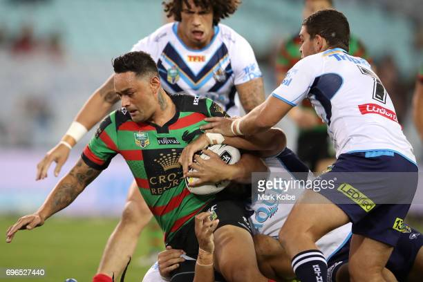 John Sutton of the Rabbitohs is tackled during the round 15 NRL match between the South Sydney Rabbitohs and the Gold Coast Titans at ANZ Stadium on...