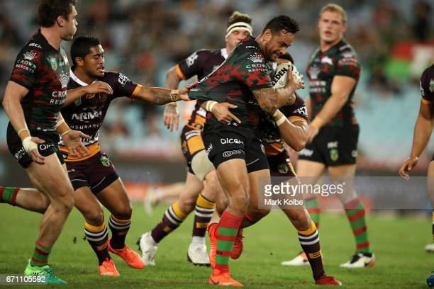 John Sutton of the Rabbitohs is tackled during the round eight NRL match between the South Sydney Rabbitohs and the Brisbane Broncos at ANZ Stadium...