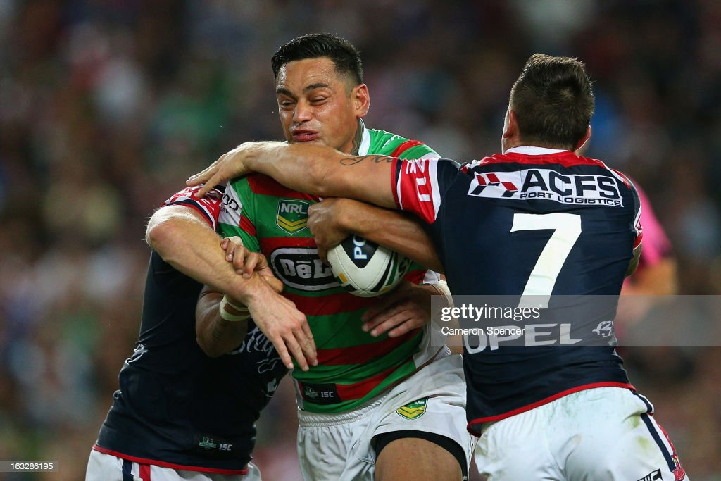 John Sutton of the Rabbitohs is tackled during the round one NRL match between the Sydney Roosters and the South Sydney Rabbitohs at Allianz Stadium on March 7, 2013 in Sydney, Australia.