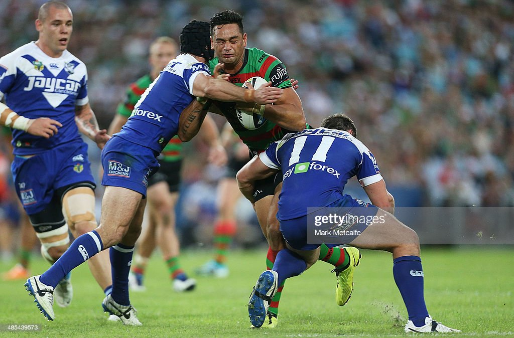 John Sutton of the Rabbitohs is tackled during the round seven NRL match between the South Sydney Rabbitohs and the Canterbury-Bankstown Bulldogs at ANZ Stadium on April 18, 2014 in Sydney, Australia.