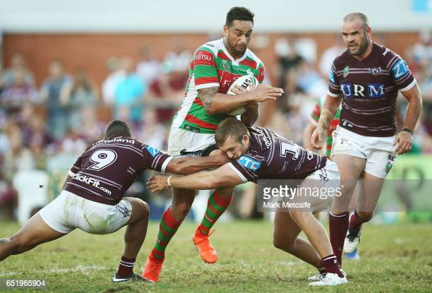 John Sutton of the Rabbitohs is tackled during the round two NRL match between the Manly Sea Eagles and the South Sydney Rabbitohs at Lottoland on...