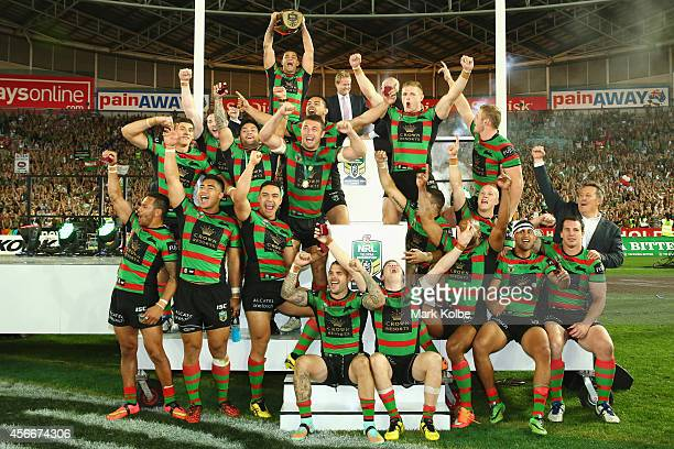 John Sutton of the Rabbitohs lifts the trophy as the Rabitohs celebrate victory during the 2014 NRL Grand Final match between the South Sydney...