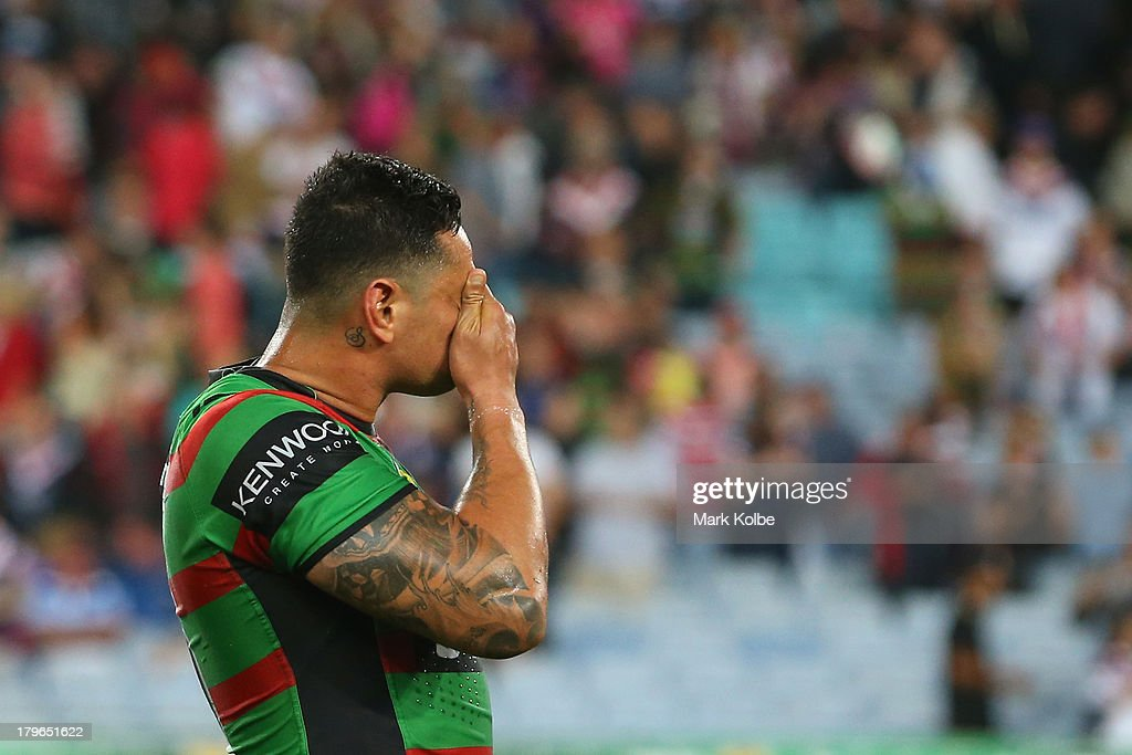 John Sutton of the Rabbitohs looks dejected after defeat during the round 26 NRL match between the South Sydney Rabbitohs and the Sydney Roosters at ANZ Stadium on September 6, 2013 in Sydney, Australia.