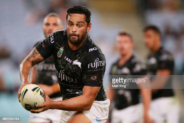 John Sutton of the Rabbitohs passes during the round ten NRL match between the Wests Tigers and the South Sydney Rabbitohs at ANZ Stadium on May 12...