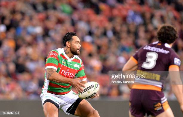 John Sutton of the Rabbitohs passes the ball during the round 14 NRL match between the Brisbane Broncos and the South Sydney Rabbitohs at Suncorp...