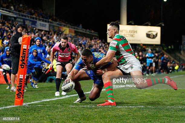 John Sutton of the Rabbitohs prevents Will Hopoate of the Eels from scoring a try during the round 19 NRL match between the Parramatta Eels and the...