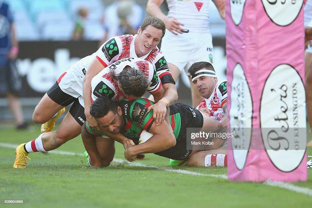 <a gi-track='captionPersonalityLinkClicked' href=/galleries/search?phrase=John+Sutton&family=editorial&specificpeople=227216 ng-click='$event.stopPropagation()'>John Sutton</a> of the Rabbitohs scores a try during the NRL Charity Shield match between the St George Illawarra Dragons and the South Sydney Rabbitohs at ANZ Stadium on February 13, 2016 in Sydney, Australia.