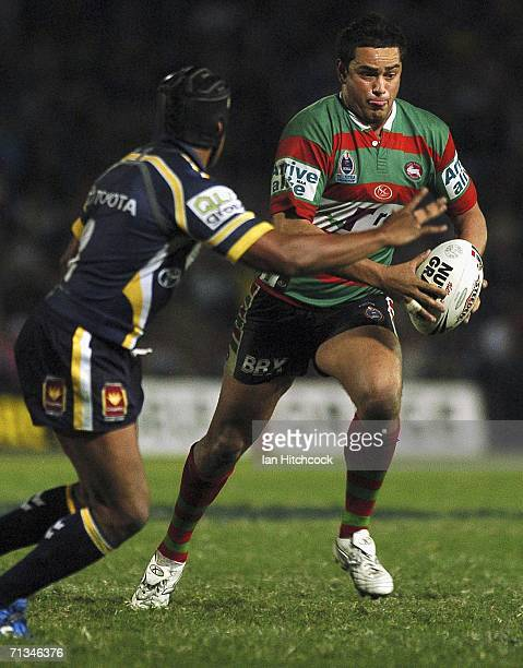 John Sutton of the Rabbitohs takes on Ty Williams of the Cowboys during the round 17 NRL match etween the North Queensland Cowboys and the South...