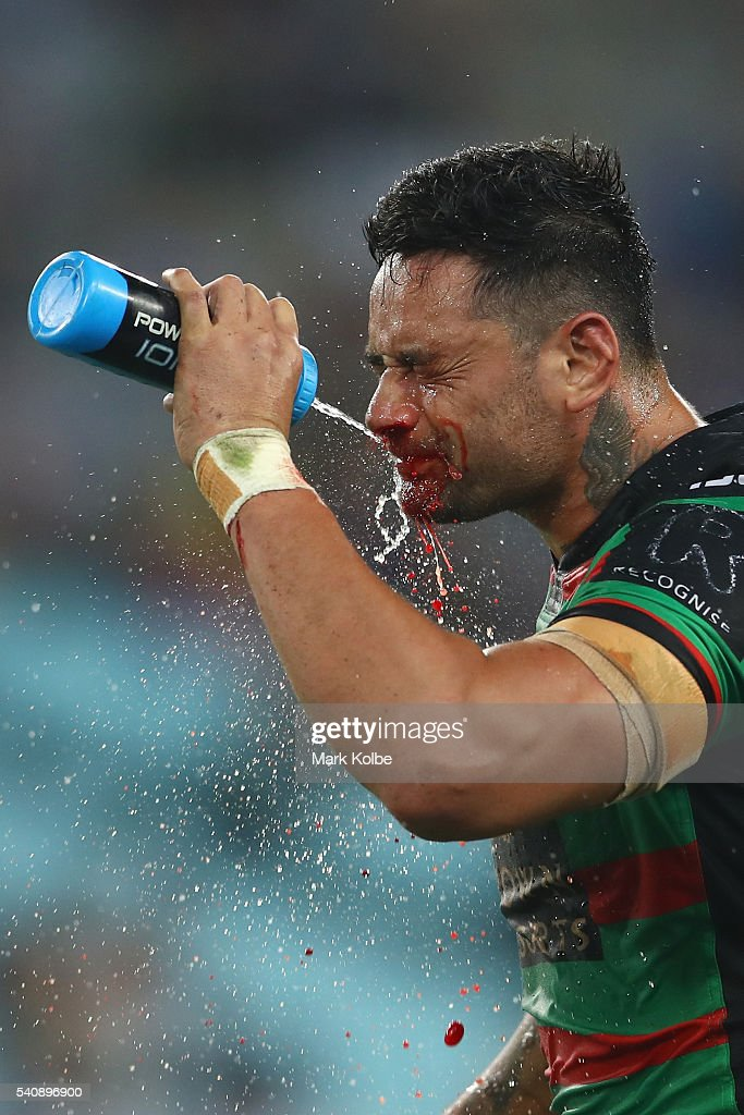 John Sutton of the Rabbitohs washes away blood from his bleeding nose during the round 15 NRL match between the South Sydney Rabbitohs and the Parramatta Eels at ANZ Stadium on June 17, 2016 in Sydney, Australia.