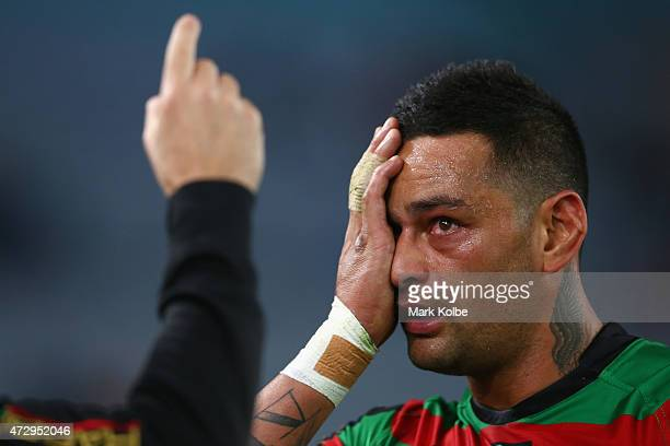 John Sutton Rabbitohs receives attention for an eye injury during the round nine NRL match between the South Sydney Rabbitohs and the St George...