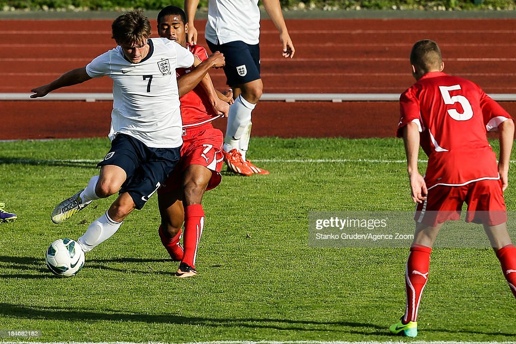 John Swift of England and Saidy Janko of Switzerland in action during the UEFA U19 Championships Qualifier between England and Switzerland, on October 15, 2013 in Ptuj, Slovenia.