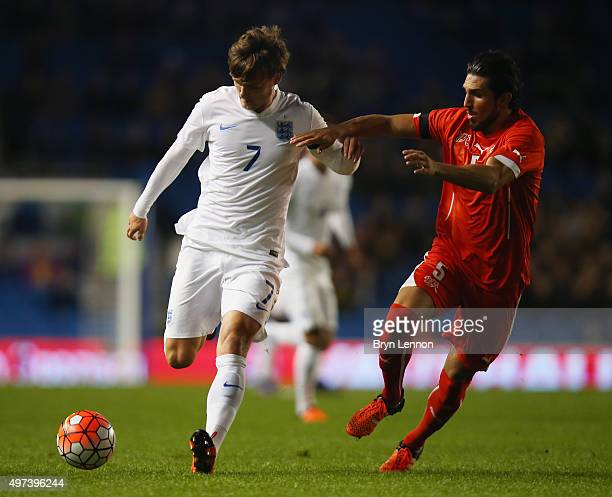 John Swift of England avoids Levent Gulen of Switzerland during the European Under 21 Qualifier between England U21 and Switzerland U21 at the Amex...