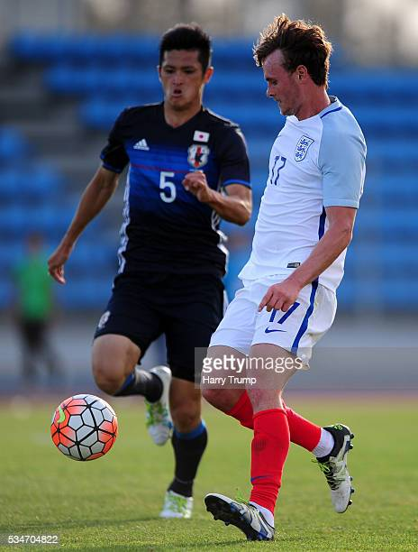 John Swift of England is tackled by Naomichi Ueda of Japan during the Toulon Tournament match between Japan and England at the Stade Leo Lagrange on...
