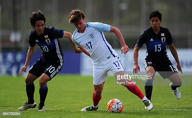 John Swift of England is tackled by Shinya Yajima of Japan during the Toulon Tournament match between Japan and England at the Stade Leo Lagrange on...