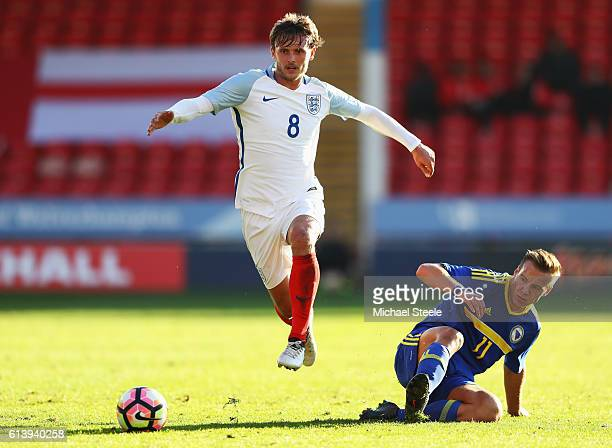 John Swift of England U21 evades Deni Milosevic of Bosnia and Herzegovina U21 during the UEFA European U21 Championship Group 9 qualifying match...