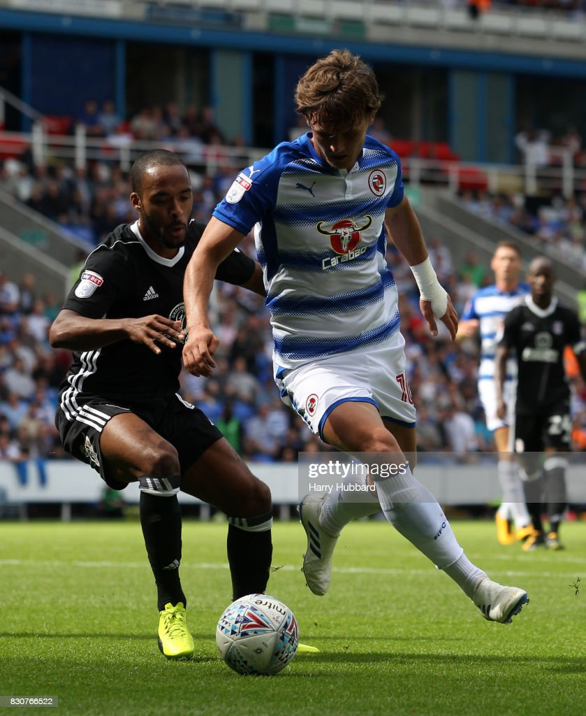 John Swift of Reading and Denis Odoi of Fulham in action during the Sky Bet Championship match between Reading and Fulham at Madejski Stadium on August 12, 2017 in Reading, England.