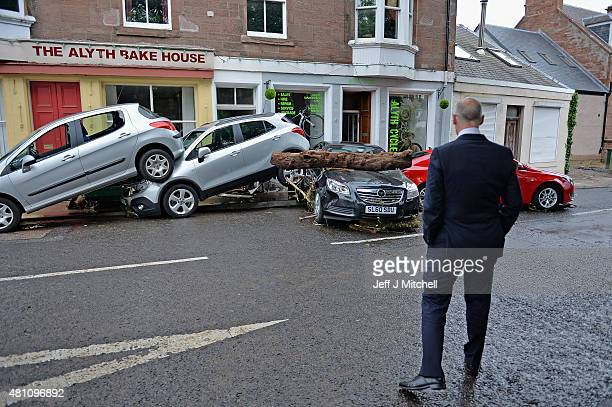 John Swinney Deputy First Minister views the cleanup following heavy rain which has caused flooding on July 17 2015 in Alyth Scotland Flooding...