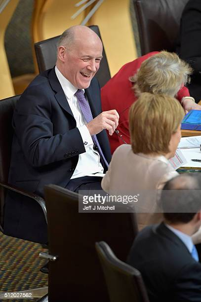 John Swinney Scottish Finance Secretary reacts after addressing the Scottish Parliament during the budget debate on February 24 2016 in Edinburgh...