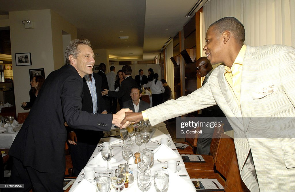 John Sykes and Shawn JayZ Carter during 2006 Music Visionary of the Year Award Breakfast at 'Fred's' at Barney's in New York City New York United...