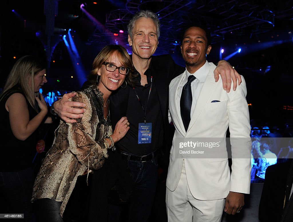 John Sykes, President, Clear Channel Entertainment Enterprises (C) and actor Nick Cannon (R) attend a private party celebrating CES 2014 hosted by iHeartRadio featuring a live performance by Krewella at Haze Nightclub at the Aria Resort & Casino at CityCenter on January 8, 2014 in Las Vegas, Nevada.