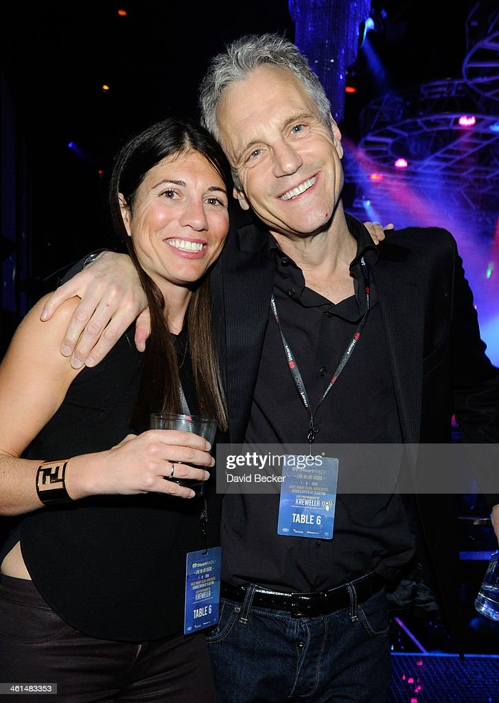 John Sykes, President, Clear Channel Entertainment Enterprises (R) attends a private party celebrating CES 2014 hosted by iHeartRadio featuring a live performance by Krewella at Haze Nightclub at the Aria Resort & Casino at CityCenter on January 8, 2014 in Las Vegas, Nevada.