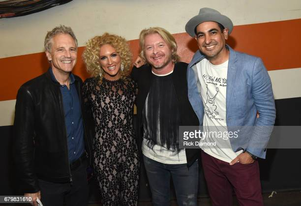 John Sykes President of Entertainment Enterprises at iHeart Media singers Kimberly Schlapman and Phillip Sweet of Little Big Town and radio...