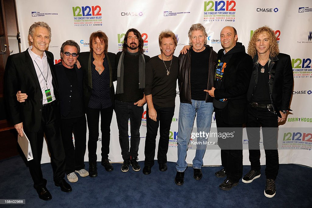 John Sykes, Tico Torres, Richie Sambora, Dave Grohl, Jon Bon Jovi, Roger Waters, Robinhood executive director David Saltzman and David Bryan backstage during '12-12-12' a concert benefiting The Robin Hood Relief Fund to aid the victims of Hurricane Sandy presented by Clear Channel Media & Entertainment, The Madison Square Garden Company and The Weinstein Company>> at Madison Square Garden on December 12, 2012 in New York City.