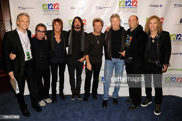John Sykes Tico Torres Richie Sambora Dave Grohl Jon Bon Jovi Roger Waters Robinhood executive director David Saltzman and David Bryan backstage...